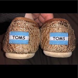 Gold slip on Toms
